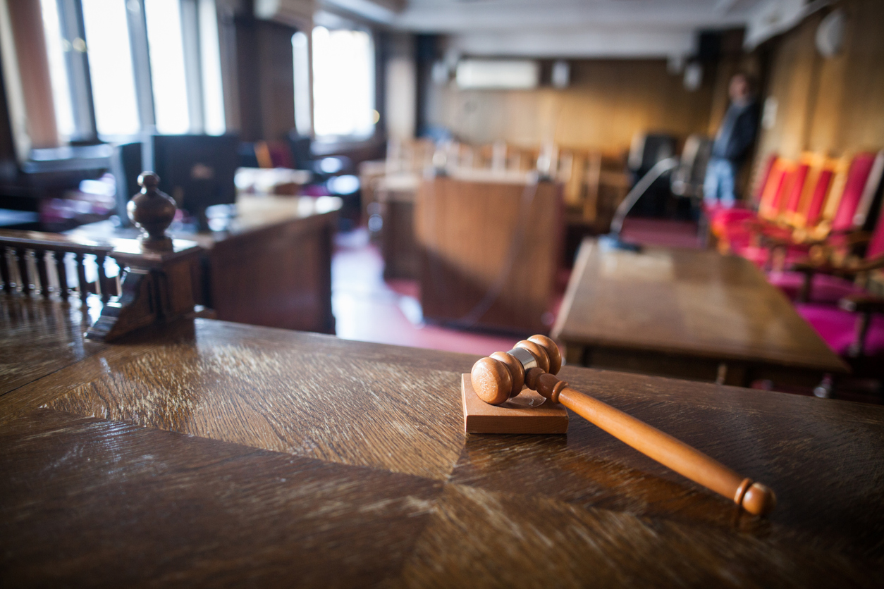 Advocacy image of a hammer in a courtroom.